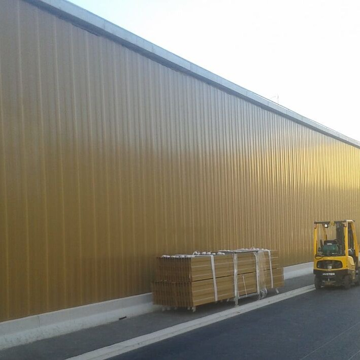 Road project with wall cladding